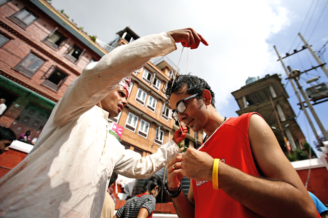 A devotee receiving janai, a sacred thread, during Janai Purnima festival in Baglamukhi, Patan, Lalitpur on Saturday, August 29, 2015. Photo: Skanda Gautam/ THT