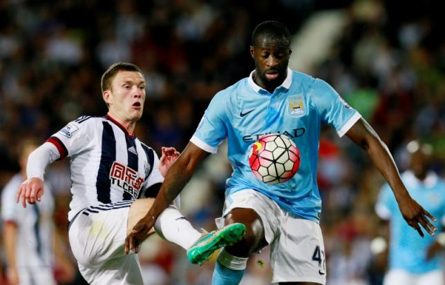 Football - West Bromwich Albion v Manchester City - Barclays Premier League - The Hawthorns - 10/8/15nManchester City's Yaya Toure in action with West Brom's Craig GardnernPhoto: Reuters / Jason Cairnduff