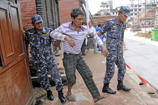 Nepal Police personnel arresting a drunk man after he was accused of harassing tourists, in Basantapur, Kathmandu, on Thursday. Photo: THT