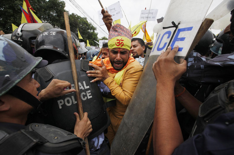 Nepali police stop Hindu activists as they try to enter a restricted area near the Constituent Assembly Hall during a protest in Kathmandu, Nepal, Wednesday, Aug. 5, 2015. Photo: AP