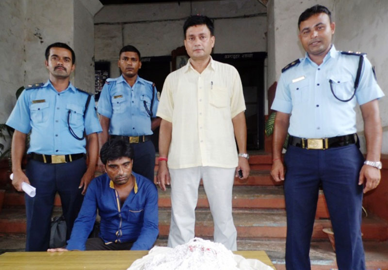 Police parading an Indian national they arrested with undeclared silver (seated), in Birgunj of Parsa, on Thursday, August 13, 2015. Photo: Ram Sarraf