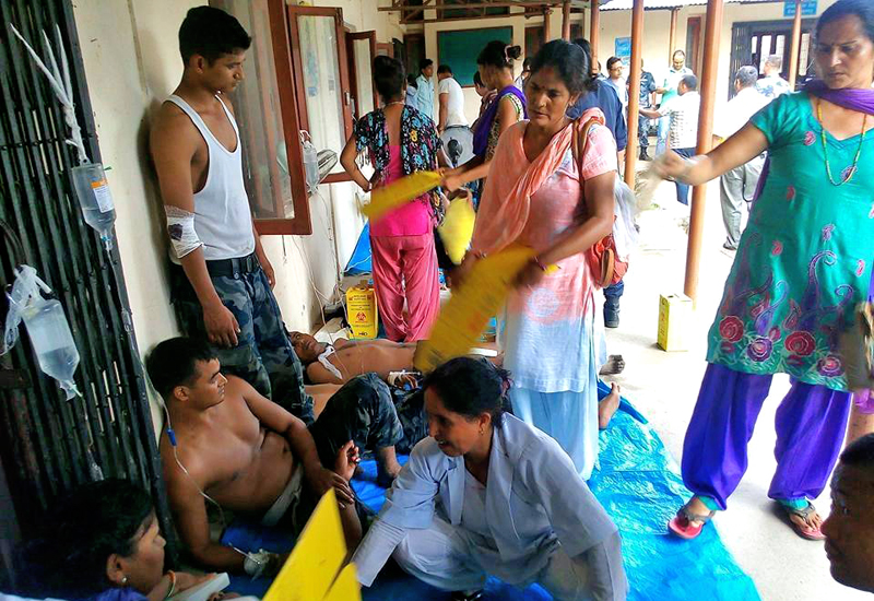 Security personnel, who were injured ina clash with demonstrators at Tikapur Municipality, receiving treatment in Tikapur Hospital, Kailali, on Monday. Photo: THT