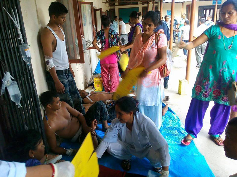 Injured police personnel undergoing treatment at the Tikapur Hospital in Kailali on Monday, August 24, 2015. Photo: THT