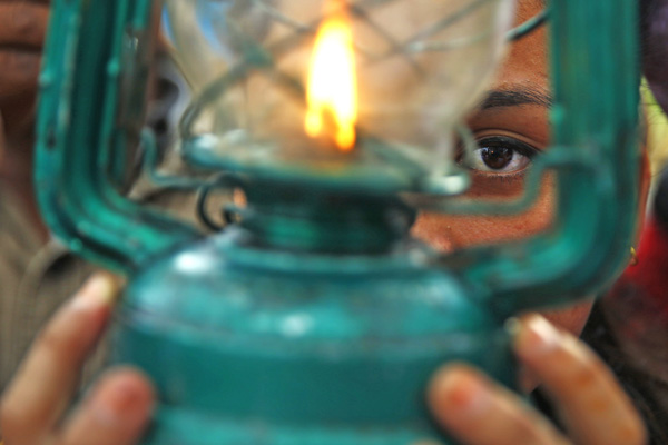 A Dalit woman holding a lantern in a protest rally demanding constitutional rights for nDalits, in New Baneshwor, Kathmandu, on Saturday. Photo: THT
