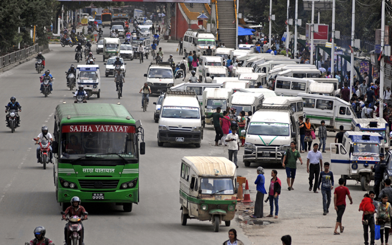 Vehicles plying on the road at Sundhara, in Kathmandu, on Sunday. The bandh called by Federation of Indigenous Nationalities had little impact on the denizens of the Valley. Photo: THT