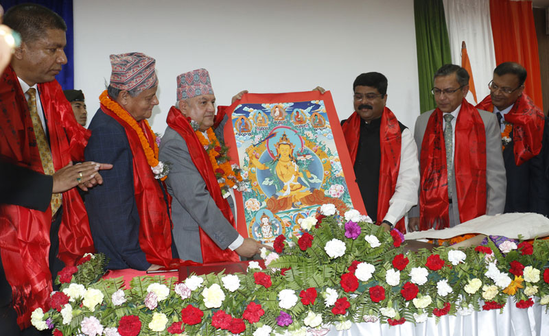 MInister for Commerce and Supplies Sunil Bahadur Thapa gifts a Paubha painting to Indian State Minister for Petroleum and Natural Gas Dharmendra Pradhan after signing the Pipeline Extension Agreement, in Kathmandu, on Monday, August 24, 2015. Photo: RSS