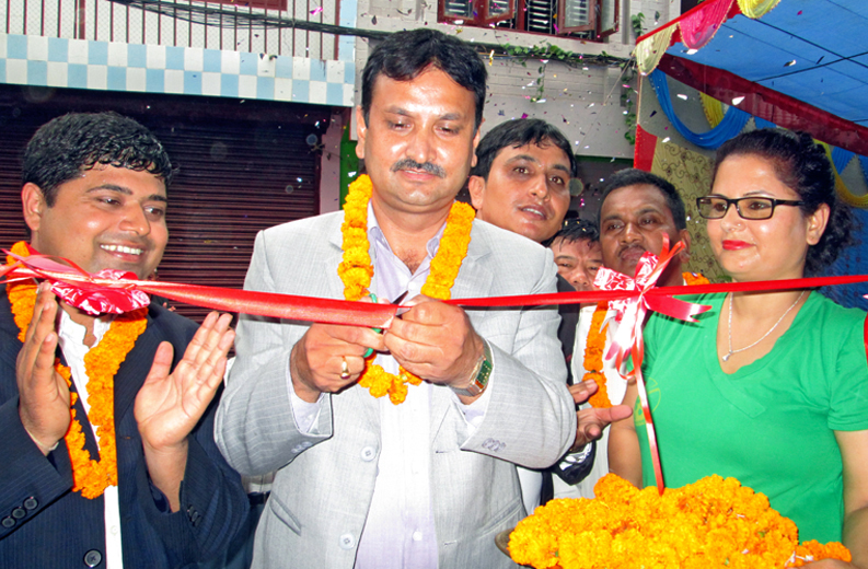 Federation of Nepali Journalists (FNJ) President Mahendra Bista inaugurating the newly constructed building of FNJ Tanahun chapter in Media Village of Byas-2, Tanahun on Friday, August 14, 2015. Photo: Madan Wagle