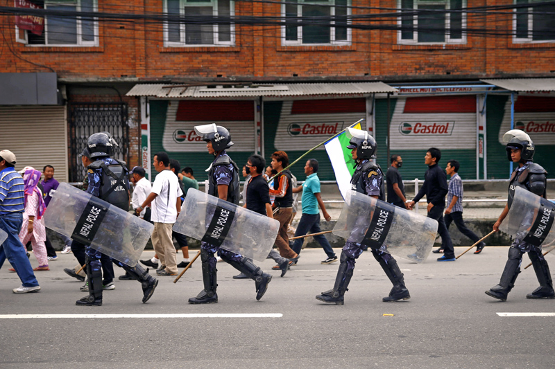 Police personnel walking along with bandh enforcers in Chabahil, Kathmandu, on Sunday. Photo: THT