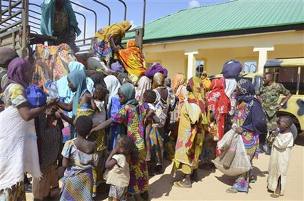 In this Thursday, July. 31, 2015 file photo, women and children rescued by Nigerian soldiers from Boko Haram extremists in the northeast of Nigeria arrive at the military office in Maiduguri. Nigerian troops rescued 178 people from Boko Haram in attacks that destroyed several camps of the Islamic extremists in the northeast of the country, an army statement said Sunday, Aug. 2. Spokesman Col. Tukur Gusau said that 101 of those freed are children, along with 67 women and 10 men. Photo: AP