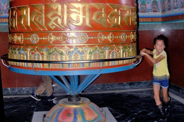 A girl spinning a prayer wheel in Swoyambhu, Kathmandu, on Thursday.