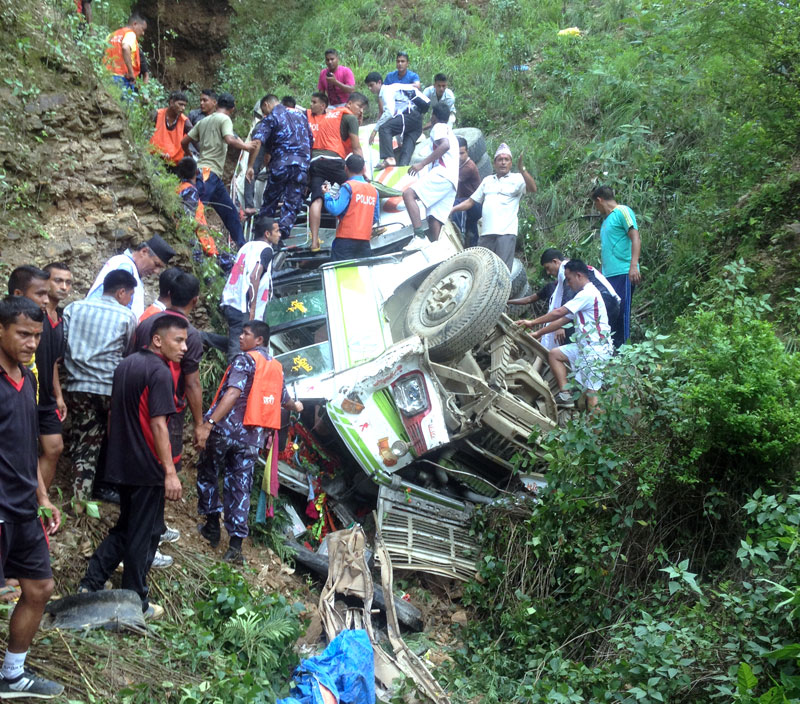 Security personnel and locals carry out the rescue operation after a bus met with an accident in Khalanga of Pyuthan on Monday, August 10, 2015. Photo: Devendra Barma