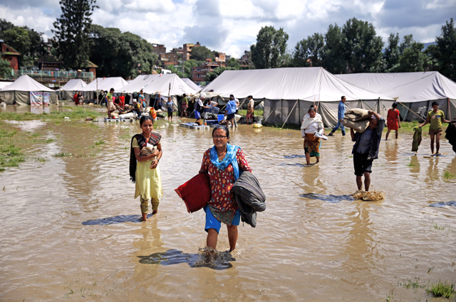 Earthquake survivors salvaging their belongings and evacuating after the flood water from the Hanumante River gushed into the human settlements in Jagati, Bhaktapur on Thursday. Photo: Skanda Gautam/ THT