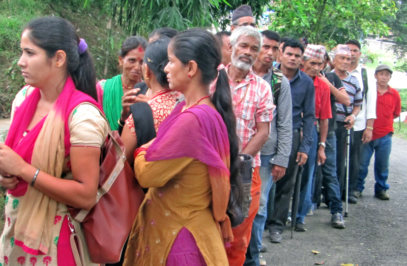 Quake victims lining up to receive the relief amount offered by Nepali Army Welfare Fund to NA personnel and former NA personnel, at Ramban Gulma, in Chapaghat, Tanahun, on Thursday. Photo: THT