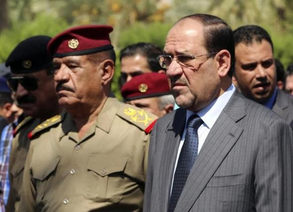 Then Iraqi Prime Minister Nuri al-Maliki  (2nd R) at the defence ministry in Baghdad in this August 13, 2014. Photo: REUTERS