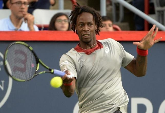 Aug 10, 2015; Montreal, Quebec, Canada;  Gael Monfils of France hits the ball against Fabio Fognini of Italy (not pictured) during the Rogers Cup tennis tournament at Uniprix Stadium. Photo: Reuters