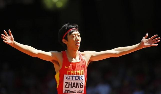 Zhang Guowei of China gestures as he competes in the men's high jump qualifying round during the 15th IAAF World Championships at the National Stadium in Beijing, China, August 28, 2015. Photo: REUTERS