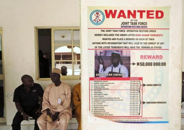 A poster advertising for the search of Boko Haram leader Abubakar Shekau is pasted on a wall in Baga village on the outskirts of Maiduguri, in the north-eastern state of Borno May 13, 2013.    Photo: REUTERS/Tim Cocks/Files