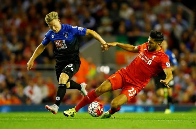 Liverpool's Emre Can in action with Bournemouth's Matt Ritchie. Photo: Reuters
