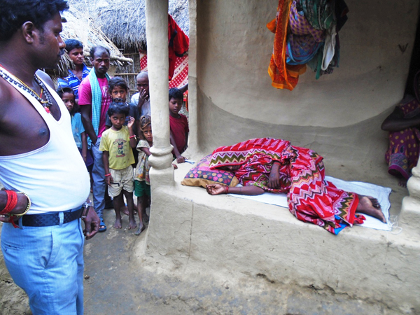 A woman suffering from diarrhoea lying on the floor outside her house at Maletha VDC, in Saptari, in August 2015. Photo: THT