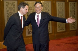 US Treasury Secretary Timothy Geithner (L) is shown the way by Chinese Vice Premier Wang Qishan (R) upon his arrival for a meeting at the Great Hall of the People in Beijing.  Source: AFP