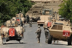 US soldiers stand guard at the site of a bomb attack in Kapisa province northeast of Bagram air base in May. Source: AFP