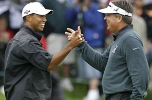 Tiger Woods, left, shakes hands with Kenny Perry after Woods chipped in from the rough on the par-4 18th hole during the Memorial Skins golf game, Wednesday, June 3, 2009, in Dublin, Ohio. Source: AP