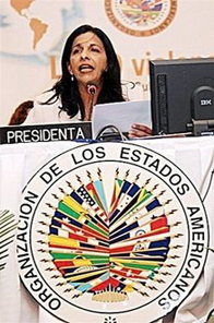 Honduras' Foreign Minister Patricia Rodas reads the Organization of American States' (OAS) agreement to readmit Cuba, during the 39th OAS' General Assembly being held in San Pedro Sula. Cuba's communist government has declared a  Source: AFP/Orlando Sierra