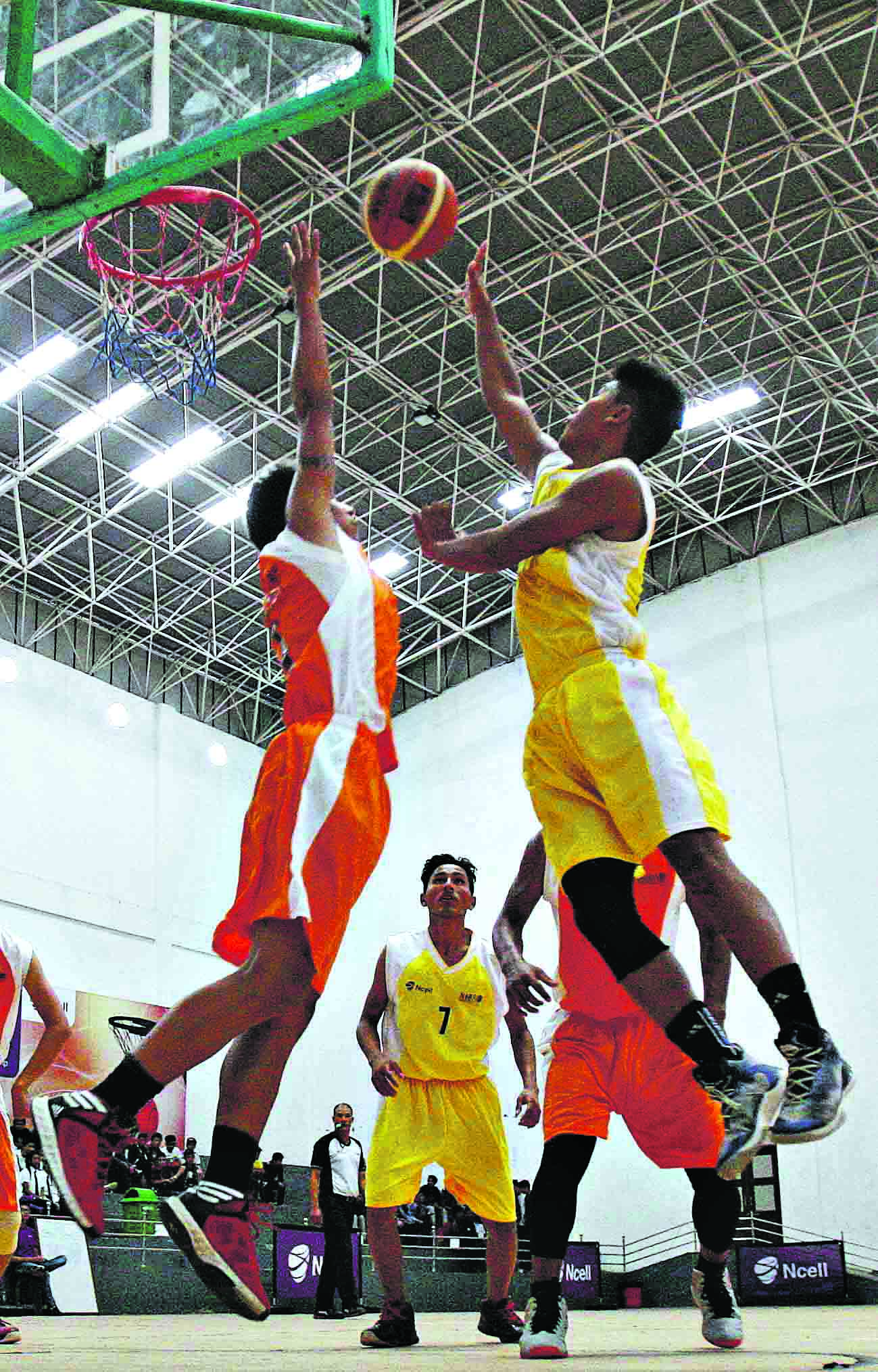 Pasang Sherpa (right) of The Times International College attempts to score while Anuj Singh of Ideal Model College during the Ncell U-18 Inter College Basketball Championship at Nepali Army Sports Complex in Lalitpur on Thursday. (Credit Image: Udipt Singh Chhetry)