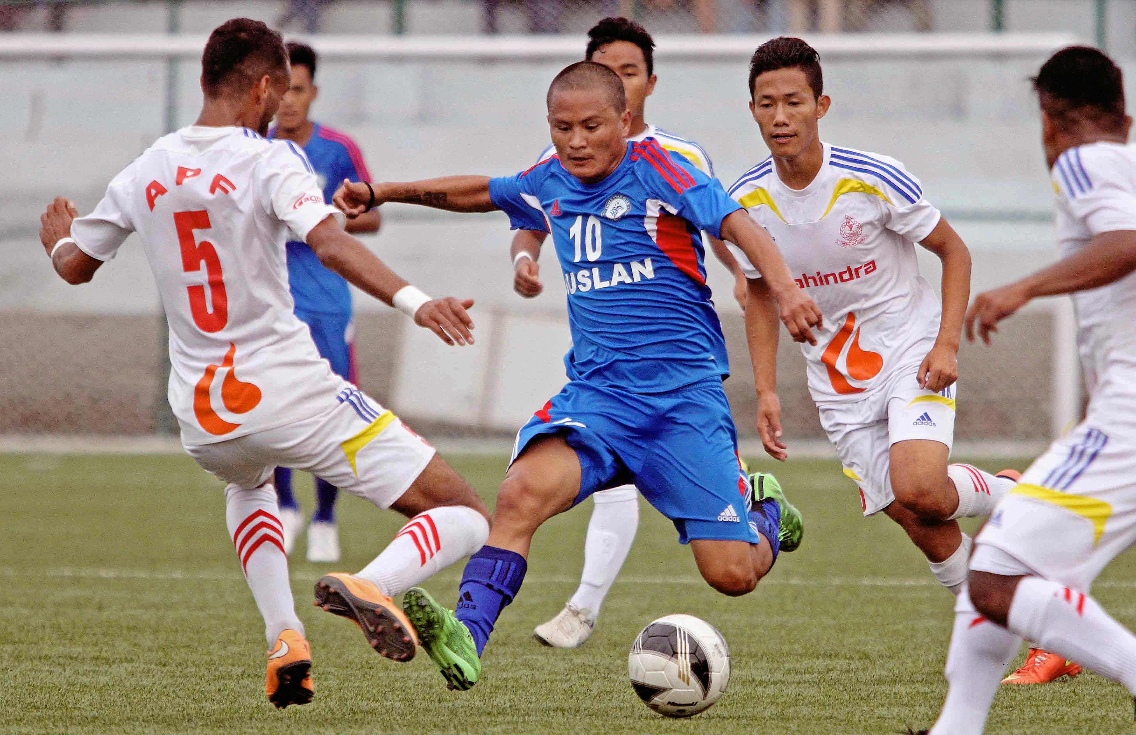 Jagjit Shrestha (center) of Three Star Club dribbles the ball against Nepal APF Club players during their Red Bull National League match at ANFA Complex in Lalitpur on Tuesday. (Credit Image: Udipt Singh Chhetry)