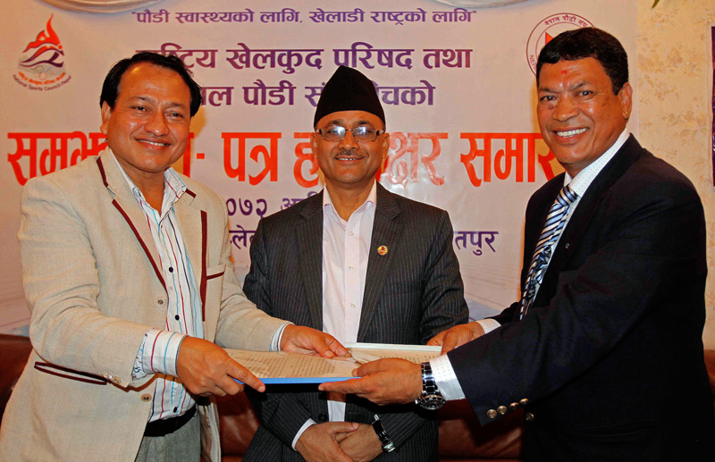 Keshab Kumar Bista (left) Member Secretary of National Sports Council exchanges MoU with Ashok Bajracharya President of Nepal Swimming Association during signing ceremony while Purushottam Paudel Minister of Youth and Sports looks on at International Sports Complex in Lalitpur on Tuesday. Courtesy: Udipt Singh Chhetry