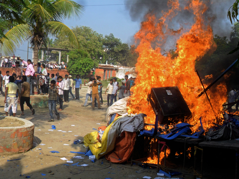 United Democratic Madhesi Front cadres setting ablaze the stage from where Baburam Bhattarai had addressed a mass at Gopal Dharamshala, in Janakpur, on Tuesday. Photo: THT