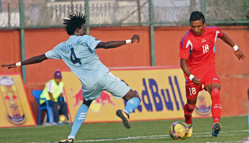 Nabayug Shrestha (right) of Tribhuvan Army Club dribbles the ball against Manang Marsyangdi Club player during their Red Bull National League match at ANFA Complex in Lalitpur on Tuesday. (Credit Image: Udipt Singh Chhetry)
