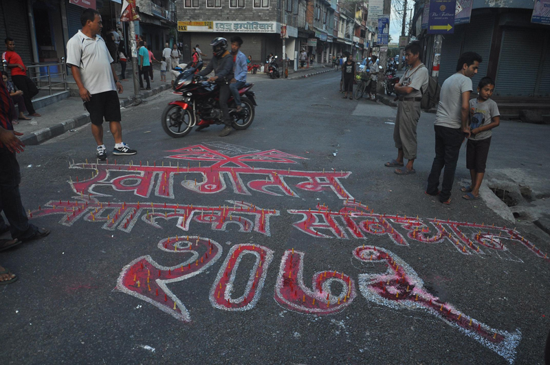 Welcoming the promulgation of Nepal's Constitution 2072 by painting on road on Wednesday September 20, 2015. Photo: RSS
