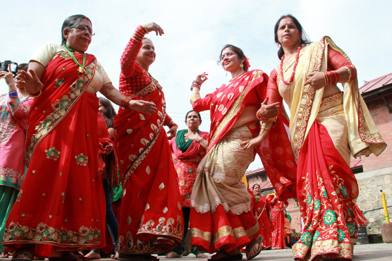 Fasting women dancing and singing while visiting Pashupatinath temple early in the morning on the occasion of Haritalika Teej  on Wednesday, September 16, 2015. Photo: RSS