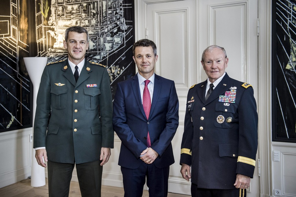Crown Prince Frederik of Denmark meets Chairman of the Joint Chiefs of Staff, US Army General Martin Dempsey (right) and Danish Chief of Defence General Peter Bartram in the Crown Prince's meeting room at Amalienborg Castle, in Copenhagen August 18, 2015. Photo: Reuters