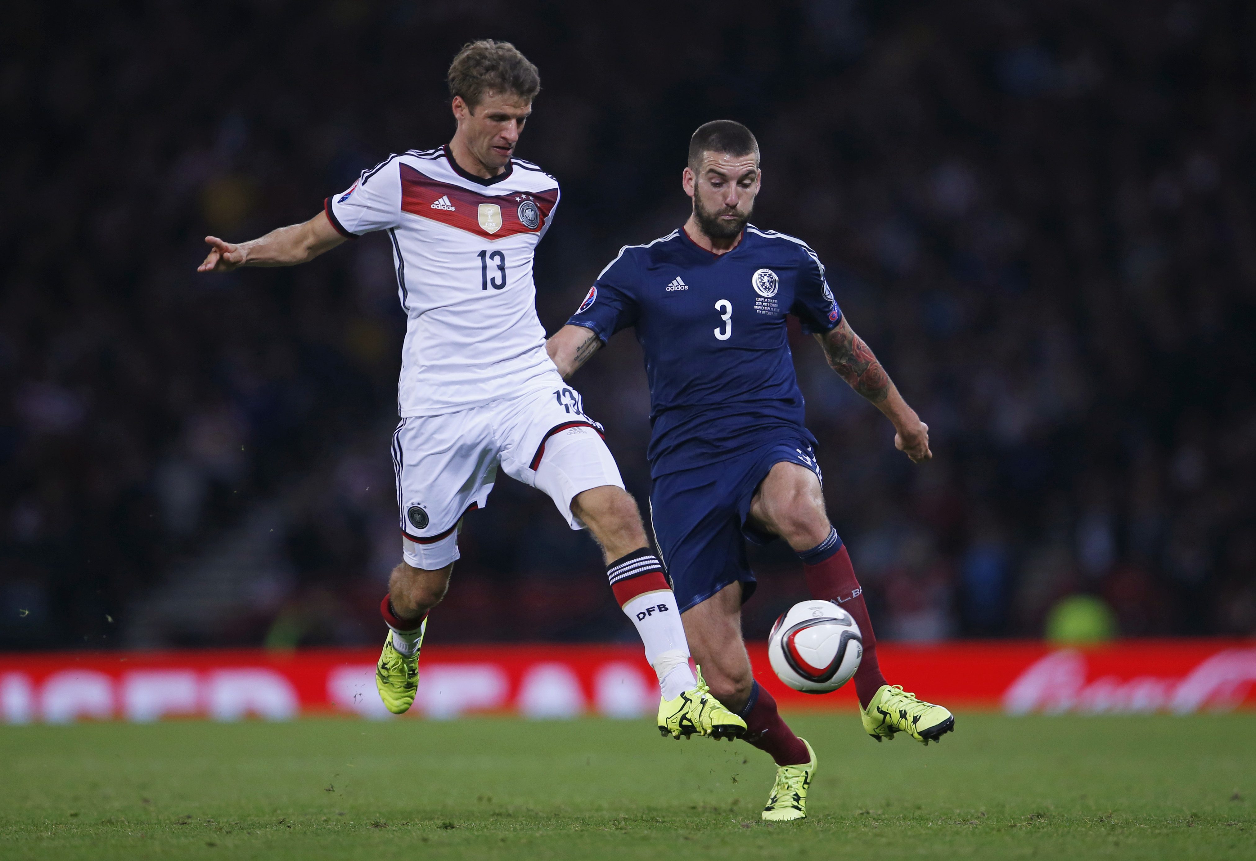 Football - Scotland v Germany - UEFA Euro 2016 Qualifying Group D - Hampden Park, Glasgow, Scotland - 7/9/15nGermany's Thomas Muller in action with Scotland's Charlie MulgrewnAction Images via Reuters / Lee SmithnLivepic