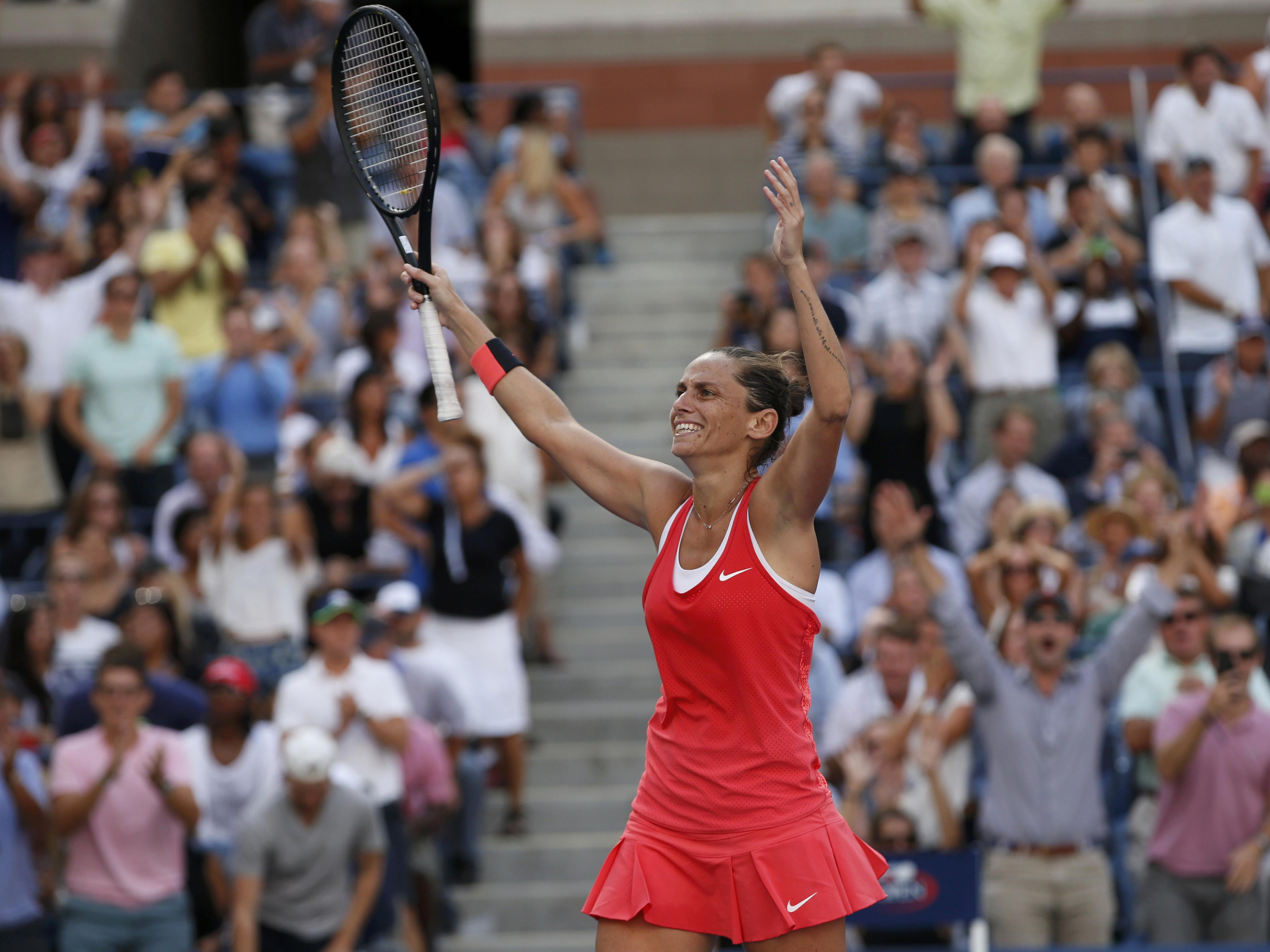 Roberta Vinci of Italy reacts after defeating Serena Williams of the U.S. in their women's singles semi-final match at the U.S. Open Championships tennis tournament in New York, September 11, 2015. REUTERS/Mike Segar