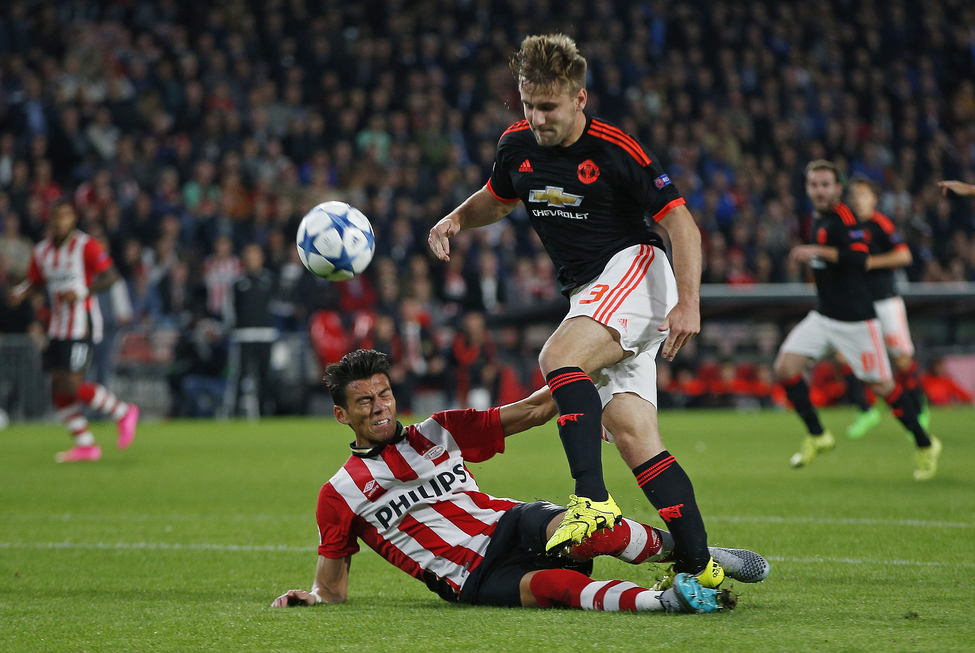 Football - PSV Eindhoven v Manchester United - UEFA Champions League Group Stage - Group B - Philips Stadion, Eindhoven, Netherlands - 15/9/15nManchester United's Luke Shaw goes down injured after this challenge from PSV's Hector MorenonAction Images via Reuters / Andrew CouldridgenLivepicnEDITORIAL USE ONLY.