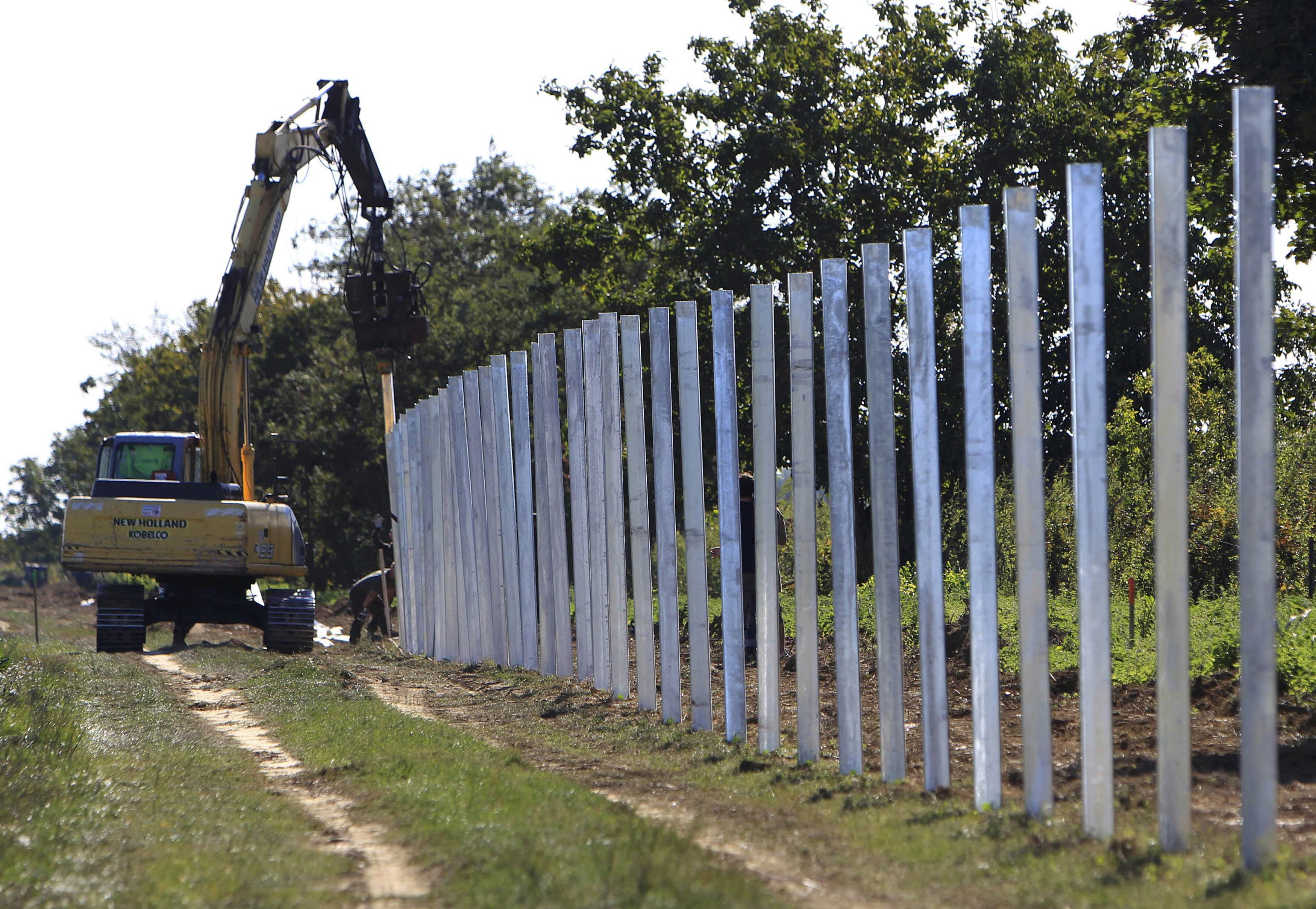The poles of a new fence on the border with Croatia are set up near Beremend, Hungary, September 21, 2015. On Sunday Hungary erected a steel gate and fence posts at a border crossing with Croatia, the EU's newest member state. Overwhelmed by an influx of some 25,000 migrants this week, Croatia has been sending them north by bus and train to Hungary, which has waved them on to Austria. REUTERS/Bernadett Szabo