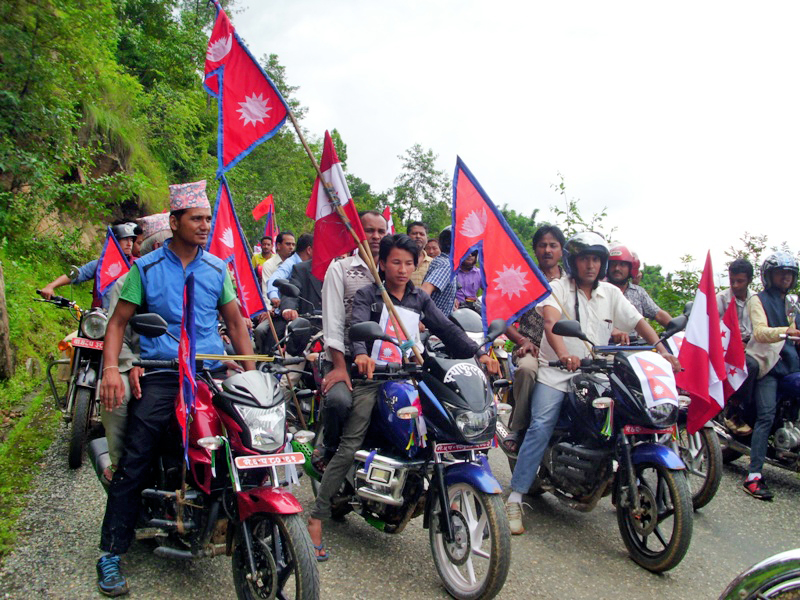 Jubilant youths in Panchthar take out a motorcycle rally on the occasion of pomulgation of new constitution 2072 in Panchthar on Monday, September 21, 2015. Photo: Laxmi Gautam