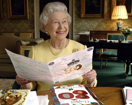 This is a April 20, 2006 file photo of Queen Elizabeth II sitting in the Regency Room at Buckingham Palace in London looking at some of the cards which have been sent to her for her 80th birthday. Photo: AP