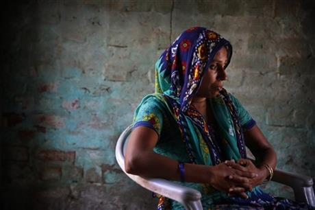 Anita Berwal, who is from the Indian southern state of Kerala and is married to Sadhuram Berwal from the northern Indian state of Haryana, sits in their home in Sorkhi village, 150 kilometers (93 miles) west of New Delhi. Berwal's husband traveled 2,700 kilometers (1,700 miles) to meet her since Haryana is known for its shortage of brides -- the direct consequence of the skewed gender ratio in the state, due to sex-selective abortions in a society where many families prize boys over girls, mostly for economic reasons. But women who move to Haryana to get married _ especially those from the better-off south _ face enormous adjustments, practical and cultural. Photo: AP
