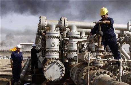 In this Dec. 13, 2009 file photo, Iraqi laborers work at the Rumaila oil refinery in Zubair near the city of Basra, Iraq. Across a Mideast fueled by oil production, low global prices have some countries running on empty and scrambling to cover shortfalls, even as more regional crude is on tap to enter the market.Photo: Ao