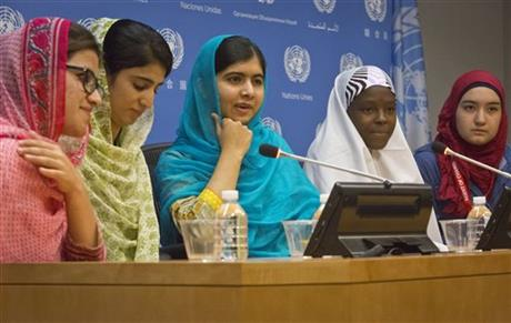 Nobel Peace Prize winner Malala Yousafzai, center, hold a press conference with her friends and youth activists Shazia Ramzan, far left, and Kainat Riaz, second from left, both from Pakistan, Amina Yusuf from Nigeria, second from right, and Salam Masri from Syria, Friday Sept. 25, 2015 at United Nations headquarters. Malala addressed the U.N. General Assembly and urged global leaders to do more to protect and empower young people. Photo: AP