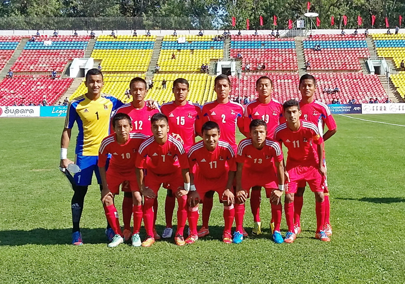 Nepal's U-16 team members pose for a group photograph prior to their AFC U-16 Qualifiers match against Jordan in Bishkek, Kyrgyzstan, on Wednesday. Nepal won the match 2-1. Courtesy: NSJF