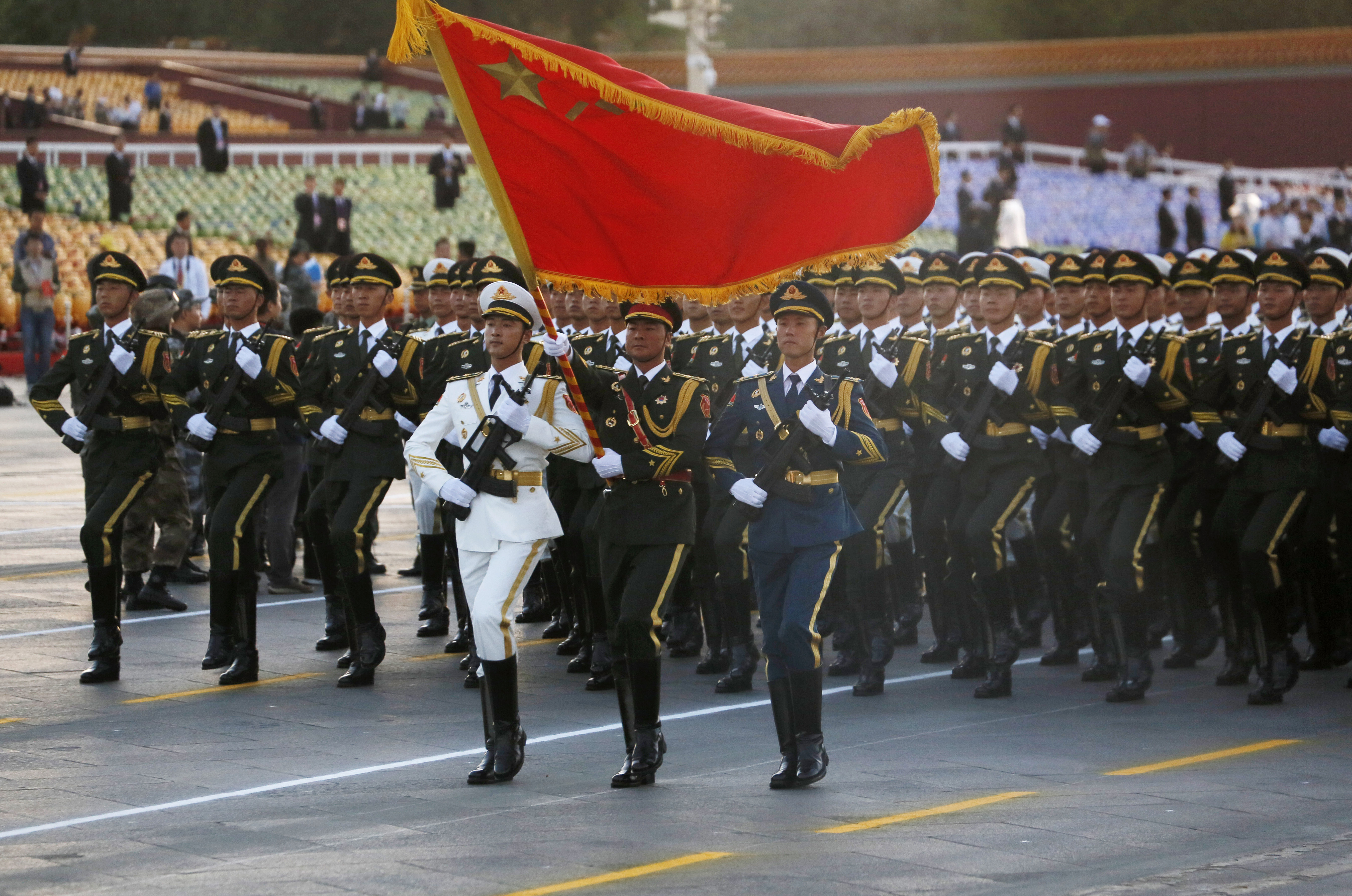 Chinese military personnel march into position ahead of a military parade commemorating the 70th anniversary of Japan's surrender during World War II held in front of Tiananmen Gate in Beijing, Thursday, Sept. 3, 2015. Photo: AP