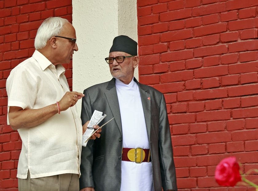 Nepali Congress Spokesperson Dilendra Prasad Badu (left) and Prime Minister and NC President Sushil Koirala chitchat after emerging from the meeting of NC Central Working Committee on Monday, September 21, 2015. Photo: RSS