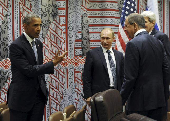 Russia's President Vladimir Putin (2nd L), Foreign Minister Sergei Lavrov (R, front), U.S. President Barack Obama (L) and U.S. Secretary of State John Kerry attend a meeting on the sidelines of the United Nations General Assembly in New York, September 28, 2015. REUTERS/Mikhail Klimentyev/RIA Novosti/Kremlin