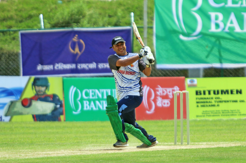 A batsman of Gorkha Brewery plays a shot against Kumari Bank during their second Century Bank Corporate Super Sixes match at the TU Stadium in Kathmandu on Saturday. Photo: THT