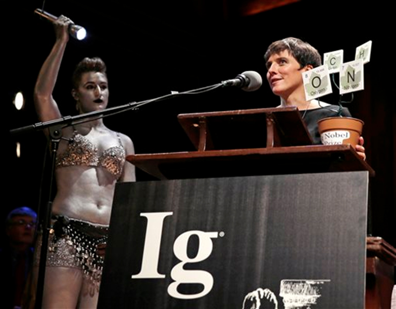 Biologist Elisabeth Oberzaucher, of the University of Vienna, accepts the prize for mathematics while being honored during a performance at the Ig Nobel Prize ceremony at Harvard University, in Cambridge, Mass., Thursday, Sept. 17, 2015. Photo: AP